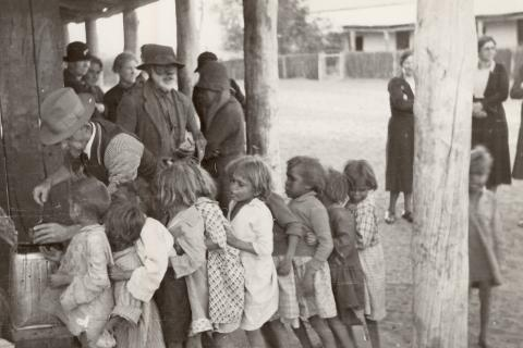 Children lining up for food Source Finke River Mission
