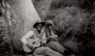 Gus Williams playing Guitar