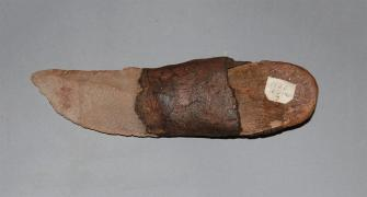 Knife made of stone and wood handle