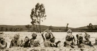 Children playing in wet sand in the Finke River c.1923