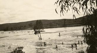 Children playing in the Finke River.